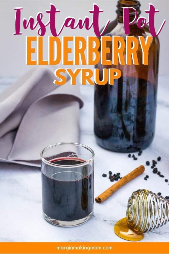 small glass of elderberry syrup that was prepared in the Instant Pot