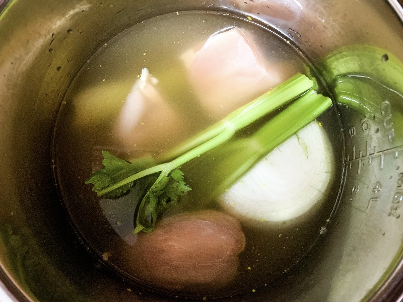 chicken, celery, onion, and broth for making chicken and dumplings