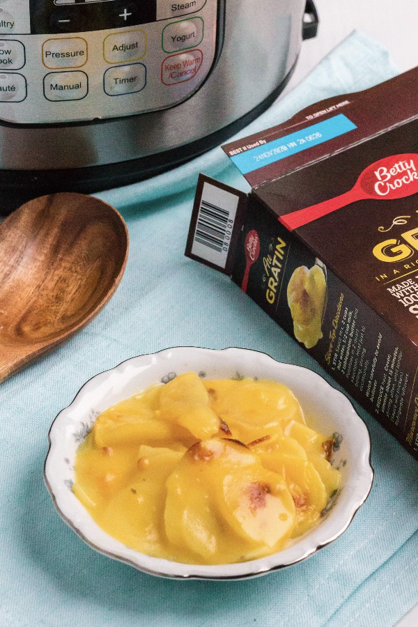 au gratin potatoes next to an Instant Pot