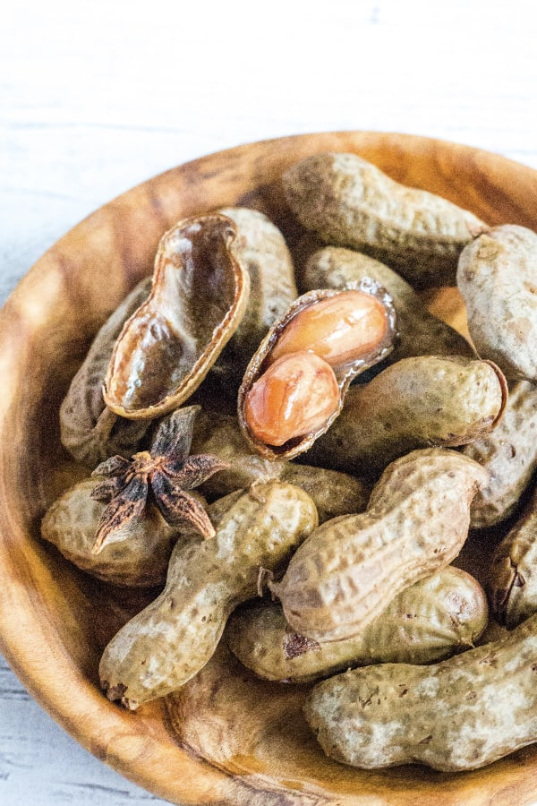 brown wooden bowl of Hawaiian style boiled peanuts