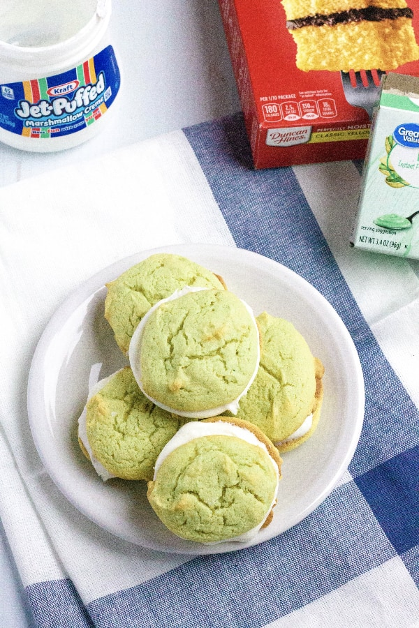 pistachio whoopie pies on a plate next to ingredients