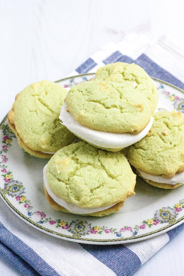 five green whoopie pies on a china plate