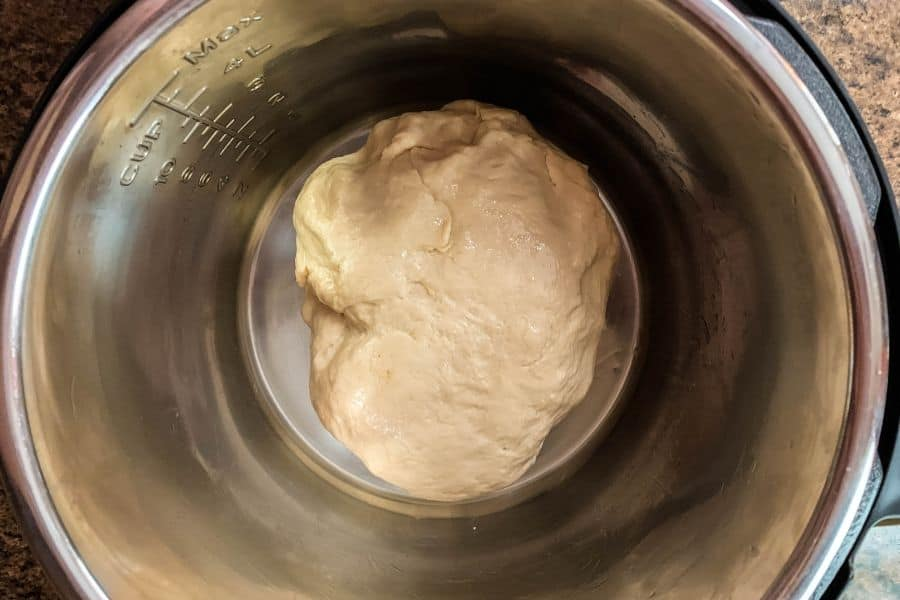 ball of pretzel dough in the insert pot of the Instant Pot