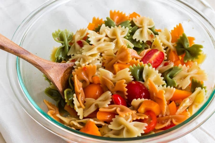 glass serving bowl of the best Italian pasta salad