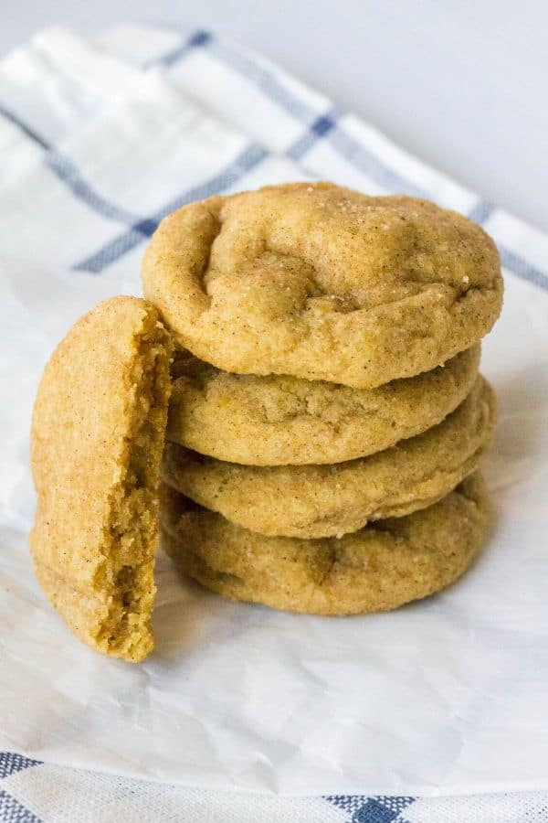 stack of apple butter snickerdoodles, with one broken in half