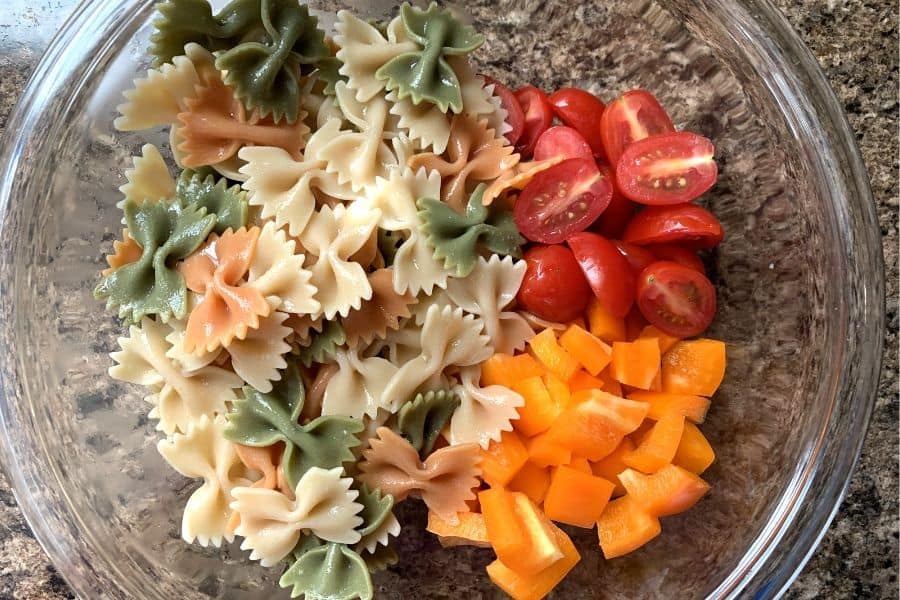 bowl of ingredients for making Italian pasta salad