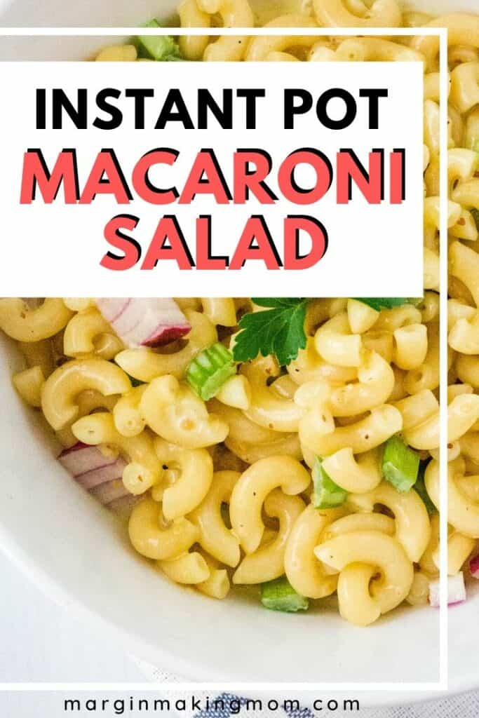 white bowl of easy macaroni salad cooked in the Instant Pot