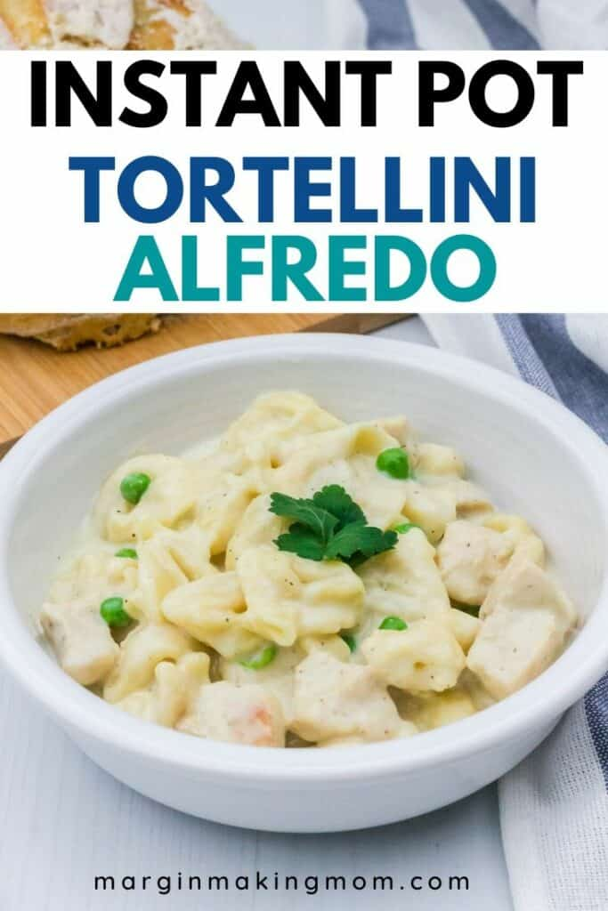 white bowl filled with tortellini alfredo and chicken