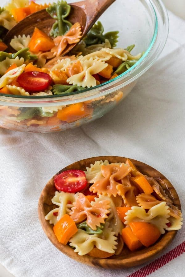 serving bowl and individual plate of Italian pasta salad