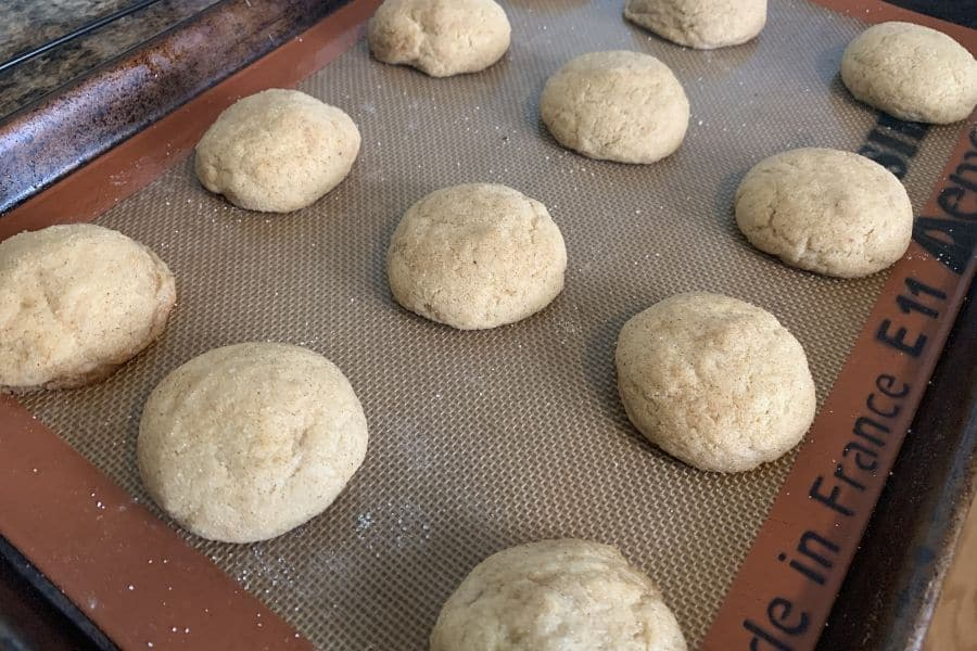 freshly baked apple butter snickerdoodles on a baking sheet