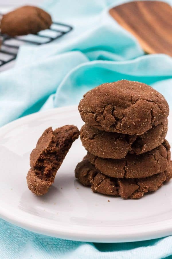 stack of chocolate snickerdoodles on a white plate