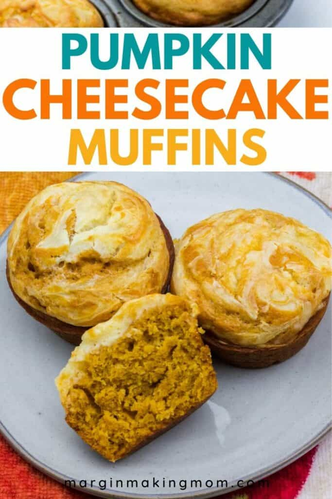 pumpkin cheesecake muffins on a gray plate, with one muffin cut in half