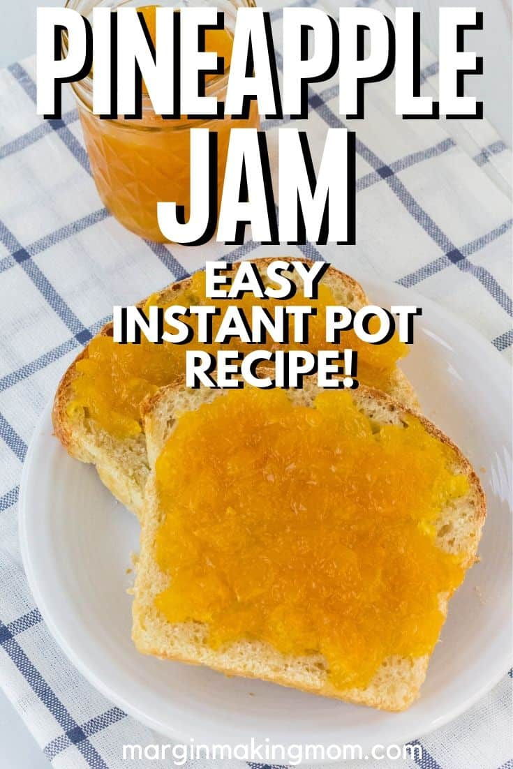 homemade Instant Pot pineapple jam spread onto a couple of pieces of bread, with the jar next to them