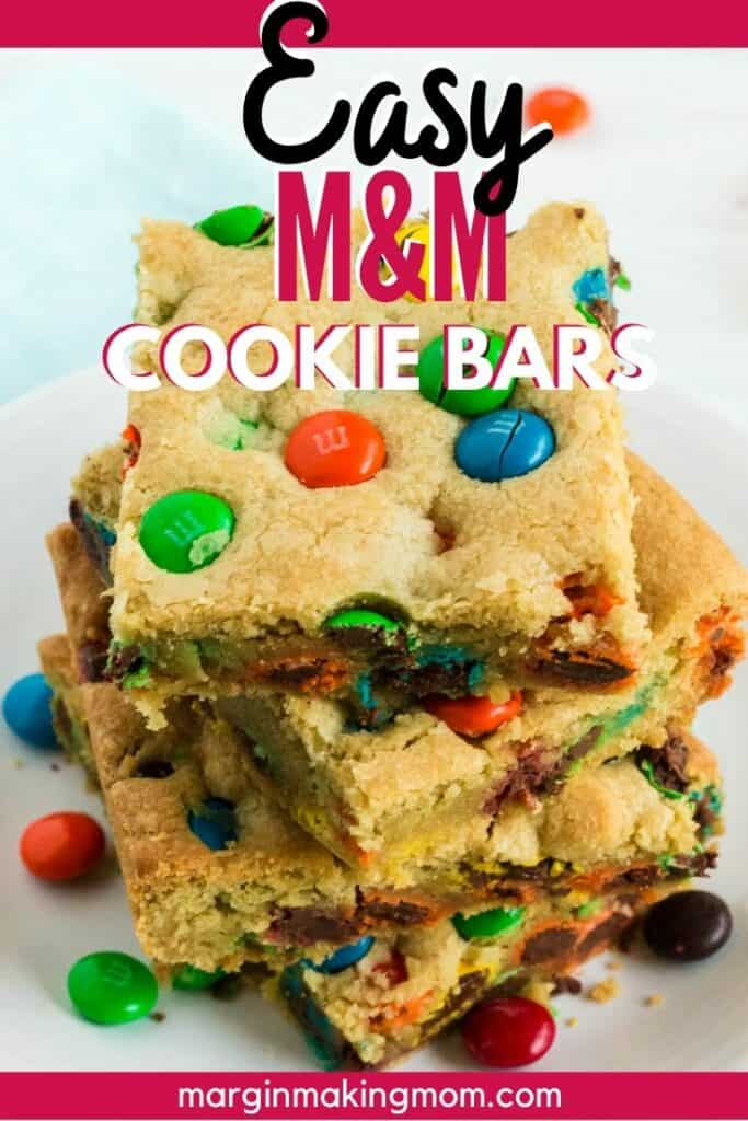 stack of M&M cookie bars on a white plate