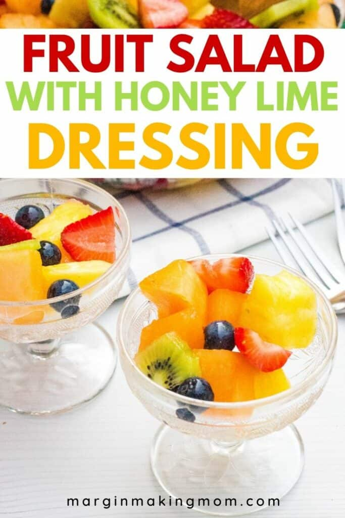 two glass dessert cups filled with honey lime fruit salad