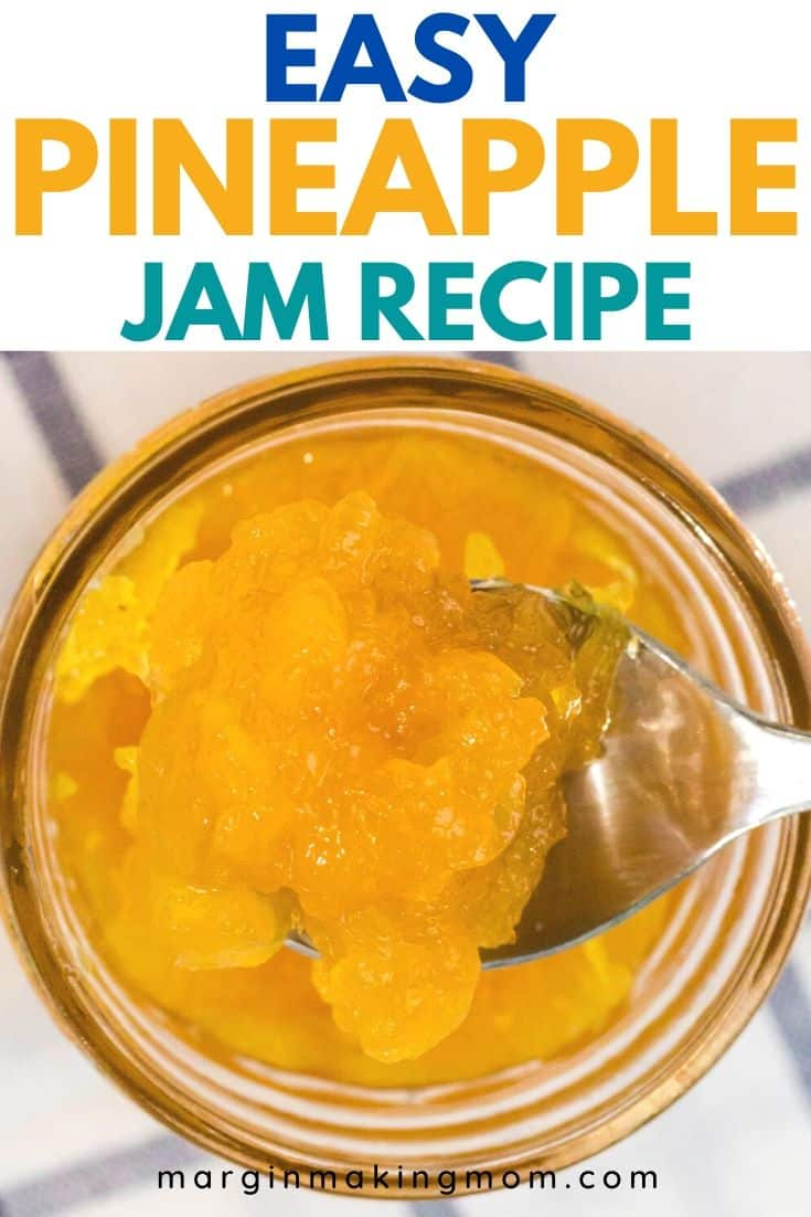 a spoon scooping out a bit of pineapple jam from a jar