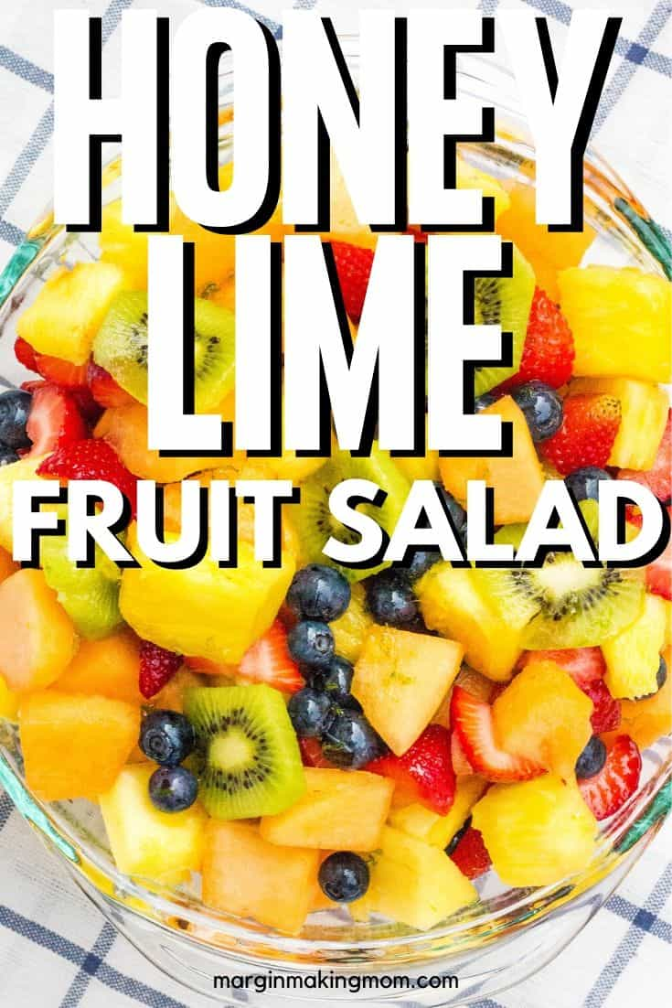 bowl of fruit salad tossed with honey lime dressing