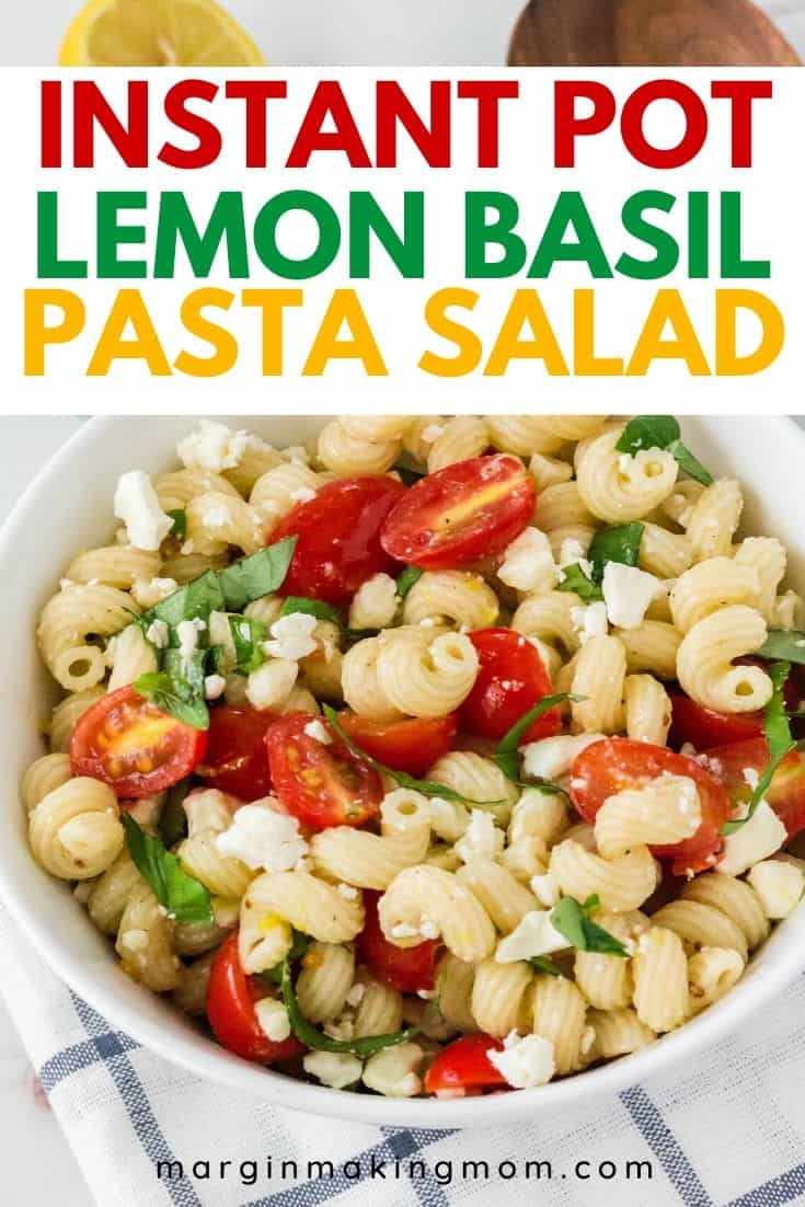 a white bowl of lemon basil pasta salad, ready to be served