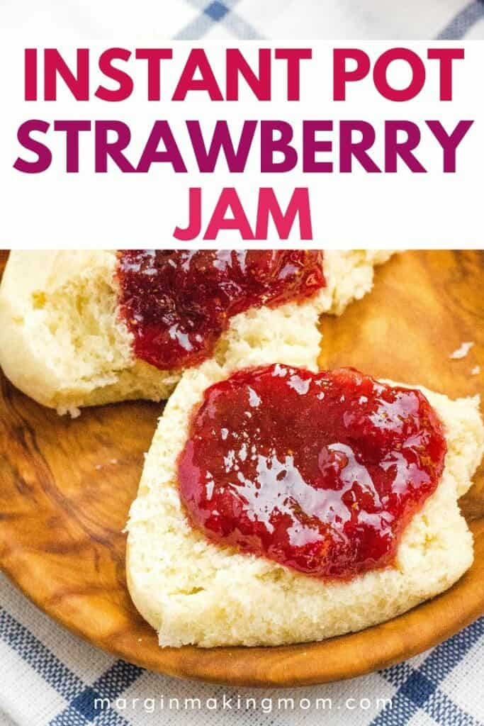 a split dinner roll spread with strawberry jam that was cooked in the Instant Pot