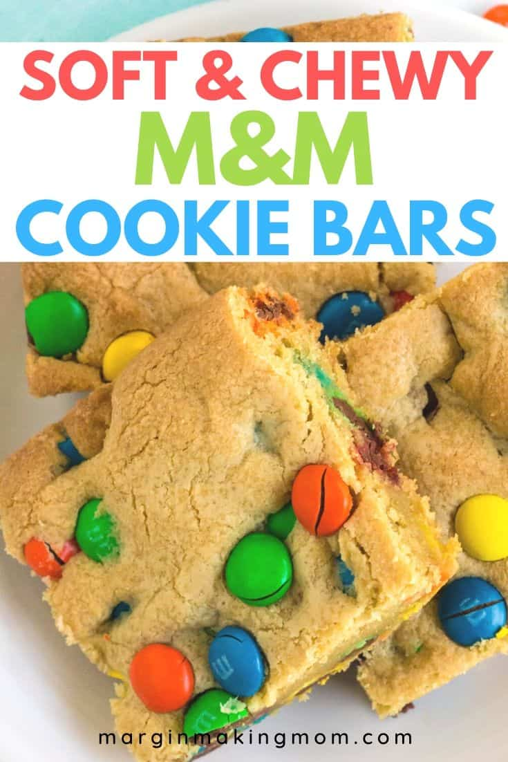 a few M&M cookie bars on a white plate