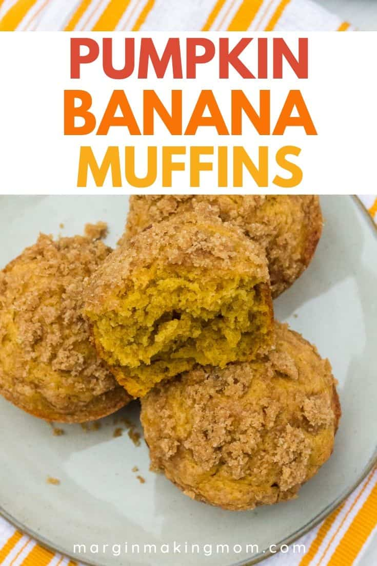 Four pumpkin banana muffins on a plate, with one muffin torn in half.