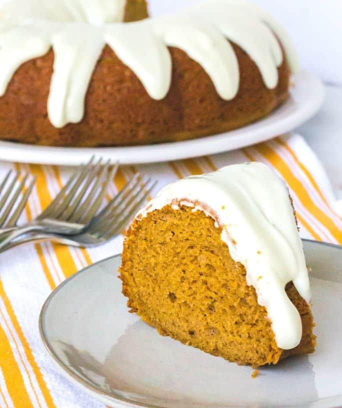 slice of pumpkin spice bundt cake on a serving plate