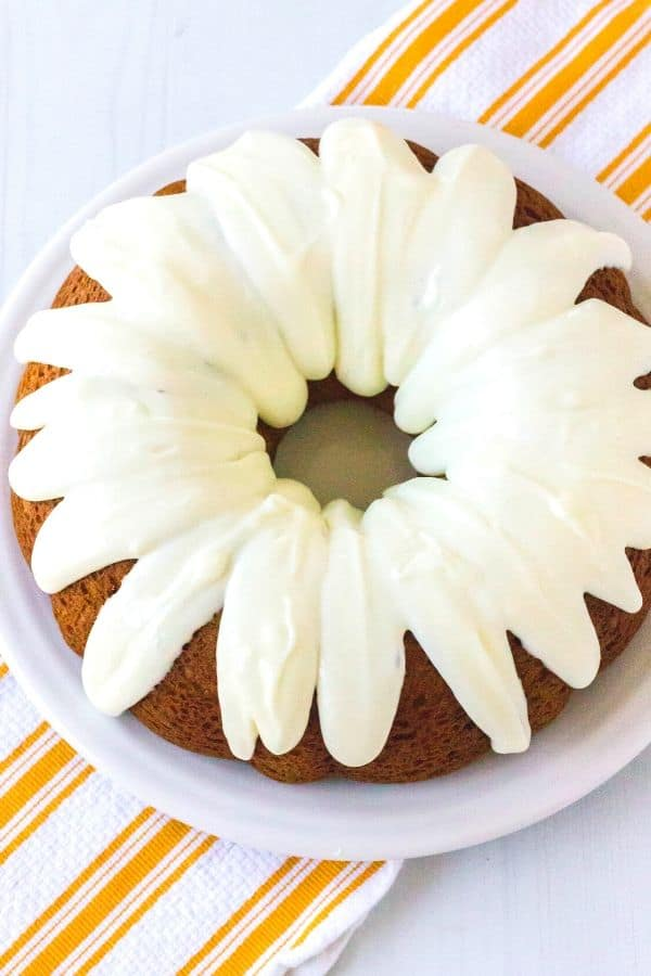 a whole pumpkin bundt cake on a white serving plate