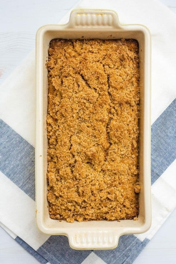 freshly baked loaf of pear bread topped with streusel, still in the pan