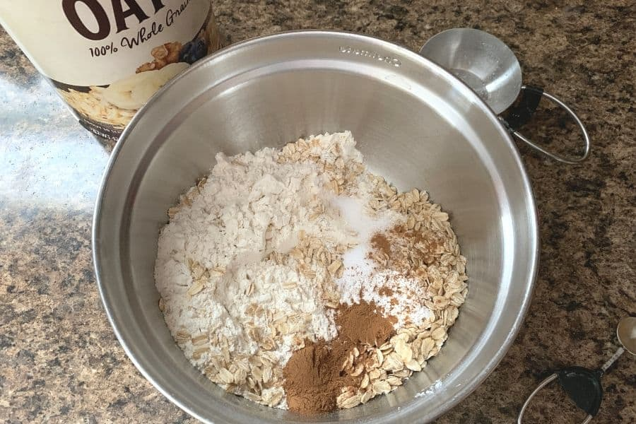 a bowl of dry ingredients for chewy oatmeal pumpkin cookies