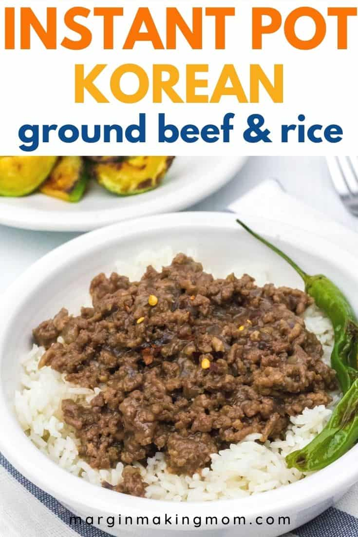 white bowl of Instant Pot Korean ground beef served over a bed of white rice