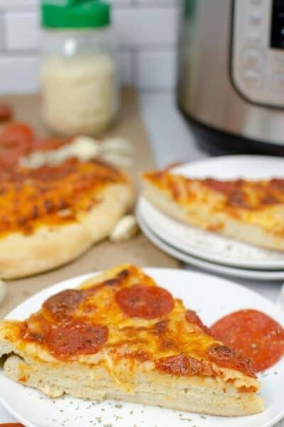 slices of pizza in front of an Instant Pot pressure cooker