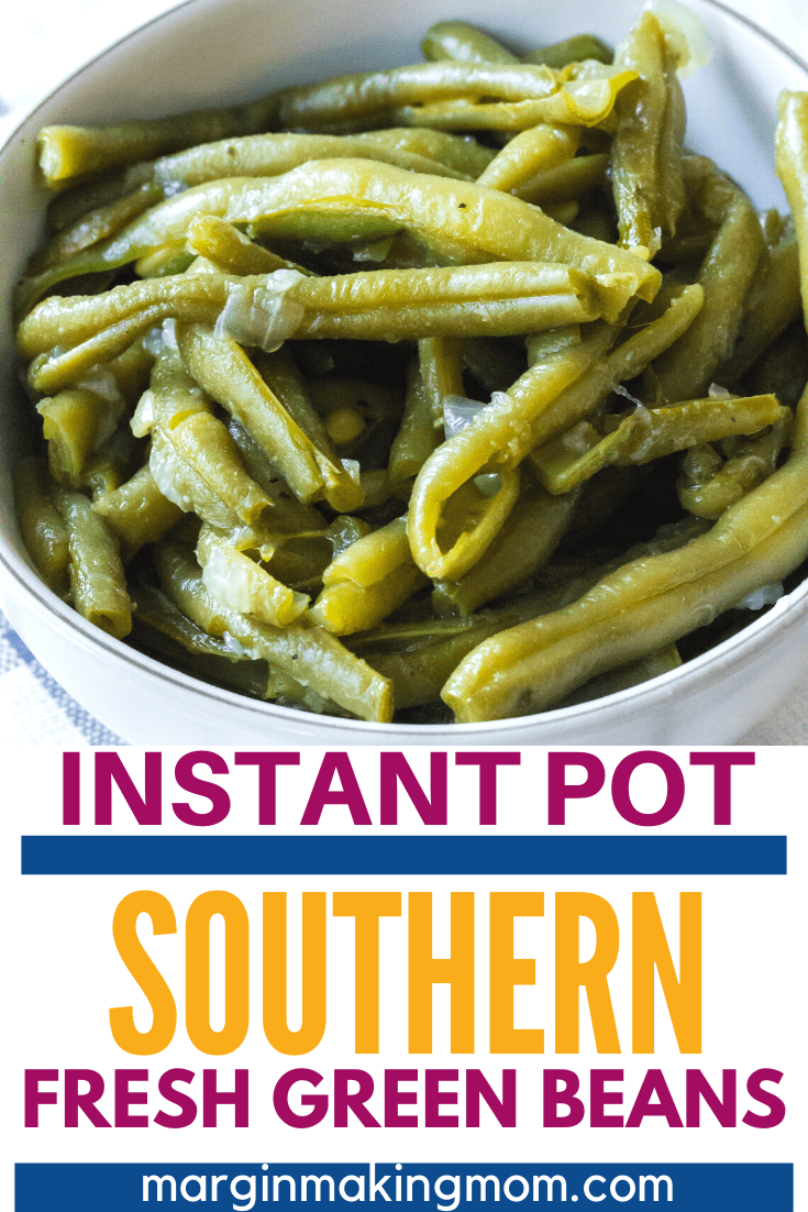 white bowl of fresh green beans cooked in the pressure cooker