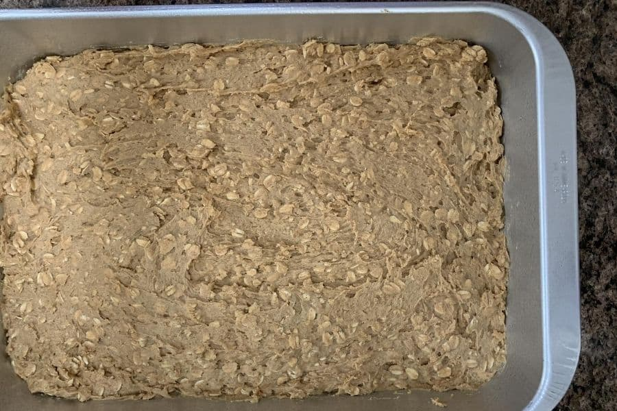 oatmeal cream pie cookie batter in a baking pan