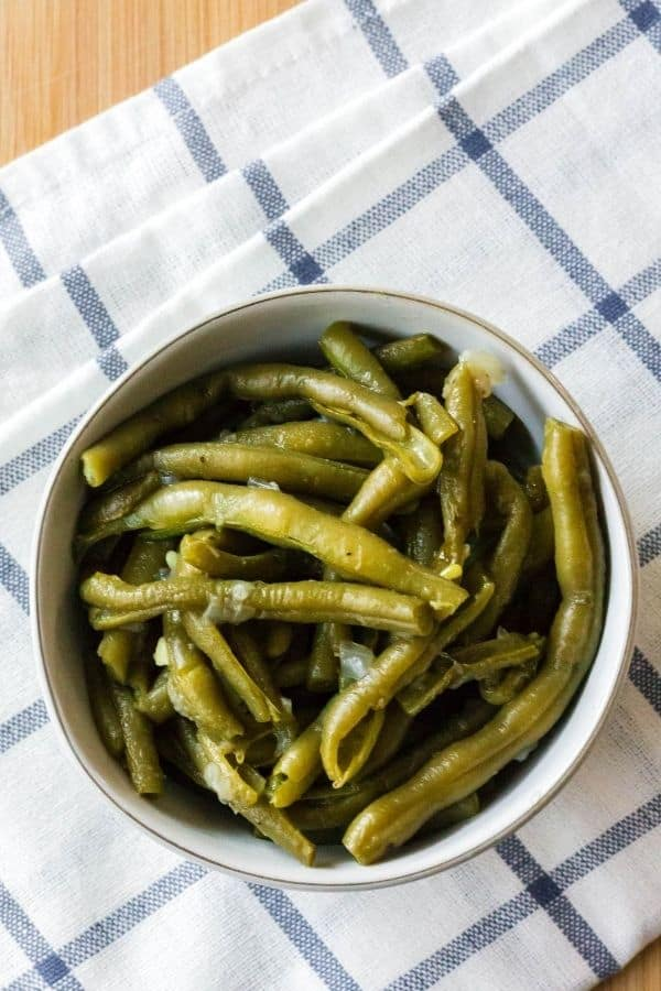 a bowl of fresh green beans that were cooked in the pressure cooker