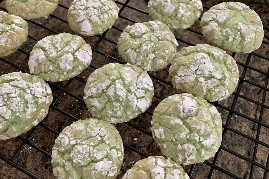 freshly baked pistachio crinkle cookies on a cooling rack