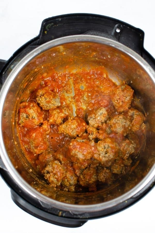 meatballs and sauce in the Instant Pot, ready to be spooned onto hoagie rolls