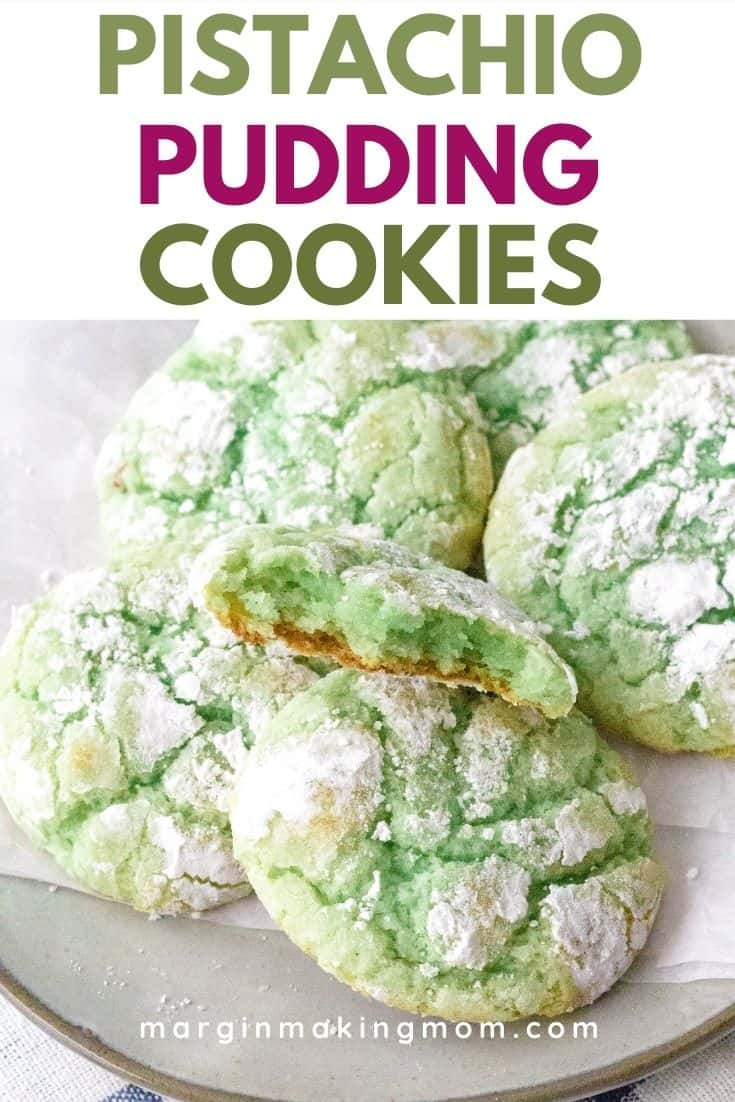a plate full of green pistachio pudding cookies with powdered sugar