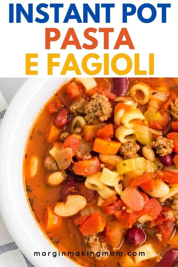 close-up view of a white bowl filled with Instant Pot pasta e fagioli soup