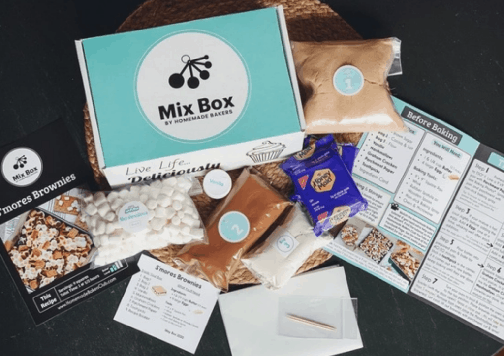 Mix Box baking subscription box with contents scattered around it