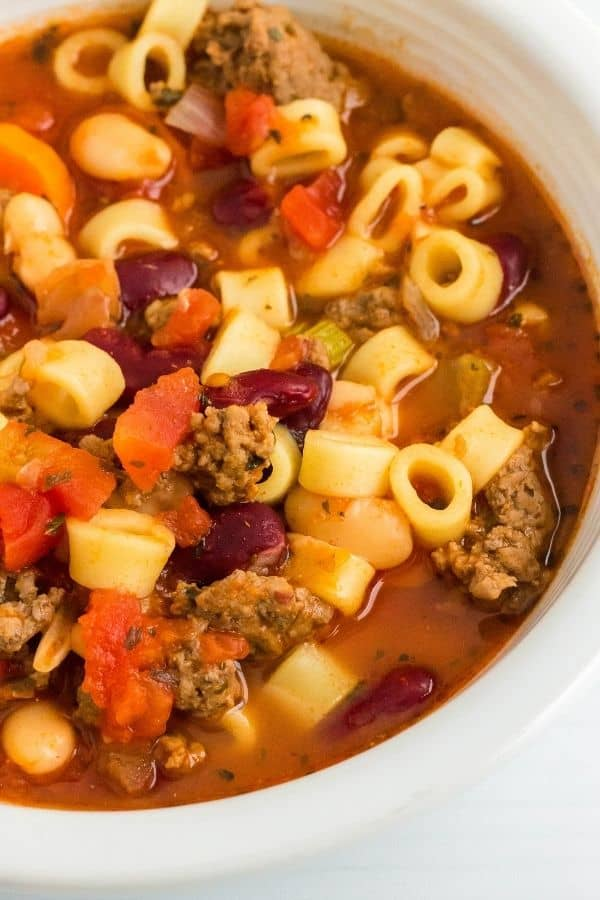 Instant Pot pasta and bean soup in a white bowl