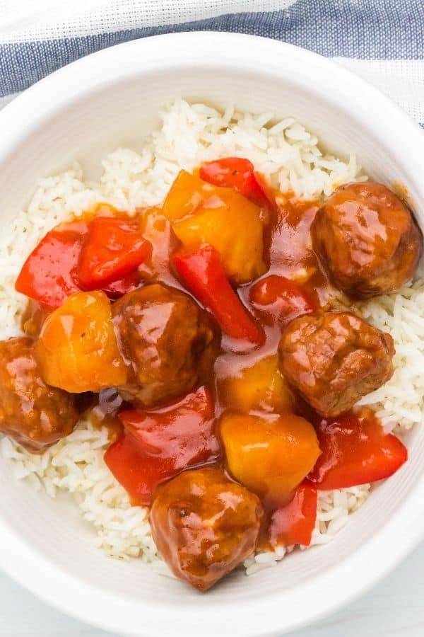 Peppers, pineapple, and meatballs in a Hawaiian sauce over rice
