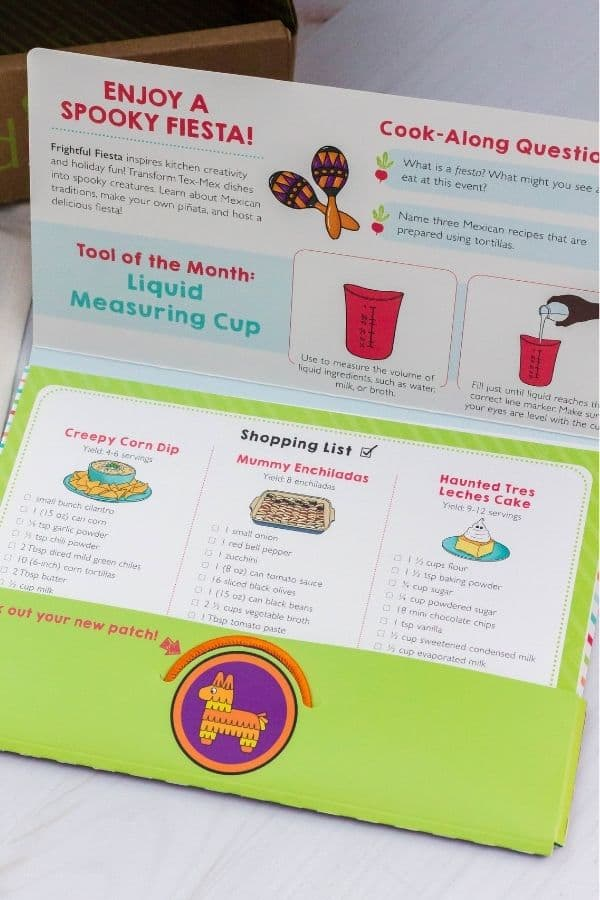 A packet including a shopping list for the recipes from the Raddish Kids Cooking Box.