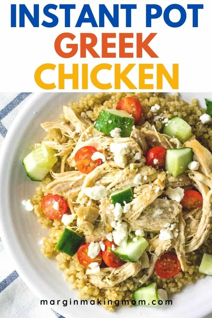 A white plate with quinoa, shredded Greek chicken cooked in the Instant Pot, tomatoes, cucumbers, and feta cheese.