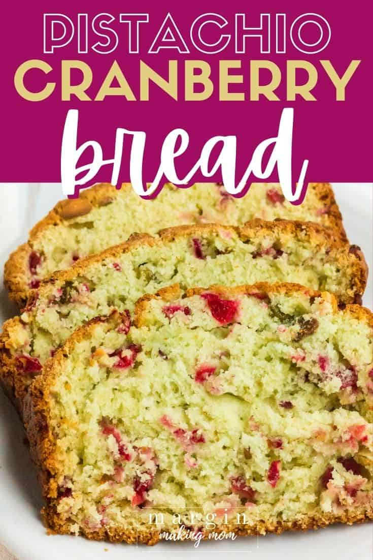 three slices of cranberry pistachio bread on a white plate