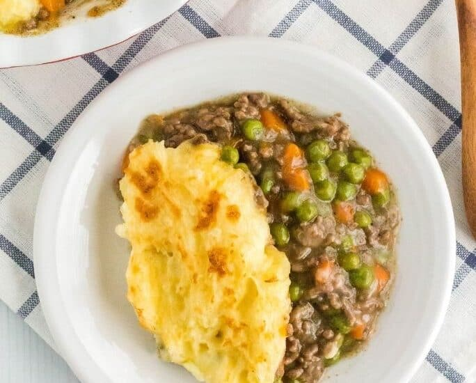 overhead view of a white plate with a serving of Instant Pot shepherd's pie on it