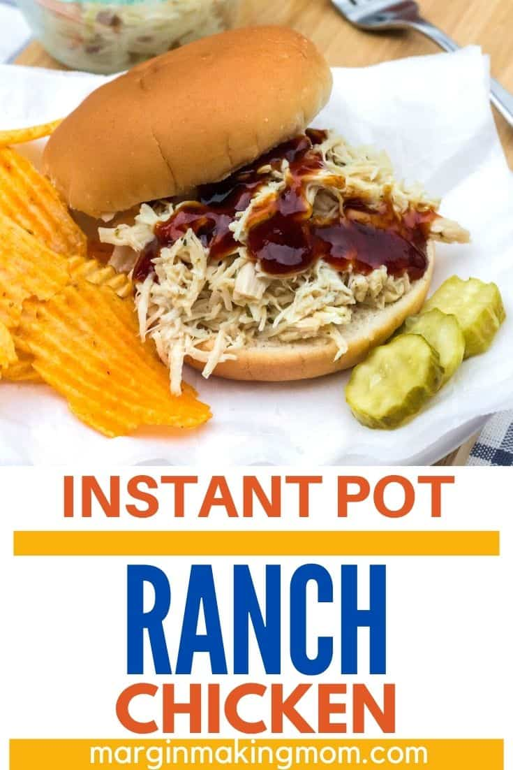 Sandwich made with pulled ranch chicken that was cooked in the Instant Pot, served with chips and pickles and a side of cole slaw