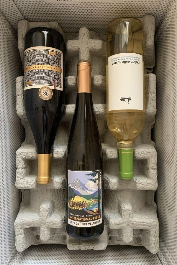 three bottles of wine in a firstleaf wine box