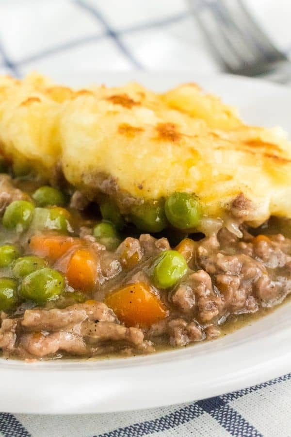 close-up view of shepherd's pie cooked in the Instant Pot, made with ground beef, vegetables, and mashed potato topping.