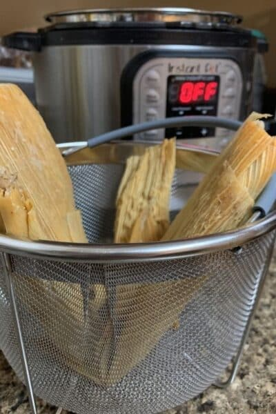 steamer basket of tamales in front of the Instant Pot