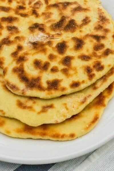 Indian restaurant styleInstant Pot naan bread on a white plate